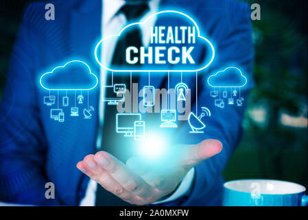 Writing note showing Health Check. Business concept for Medical Examination Wellness and general state Inspection Male wear formal work suit presentin - Stock Photo