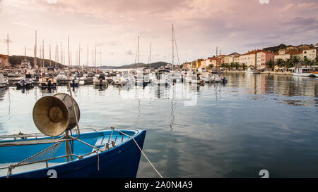 Yachts and boats at Croatian marina in n the evening. Picture in mellow tones. - Stock Photo