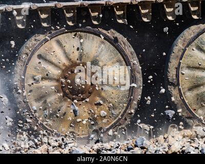 Tracks throwing rocks up frozen in mid-air midair - Stock Photo