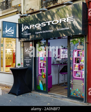 PARIS, FRANCE - SEPTEMBER 20, 2019: E-cigarettes store still open in a parisian street while more and more states are banning these products. - Stock Photo