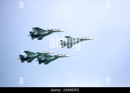 Novosibirsk, Russia, July 31, 2016, Mochishche airfield, local air show, Aerobatic team VKS 'Russian Falcons' Su-30 SM, four russian fighter aircrafts - Stock Photo
