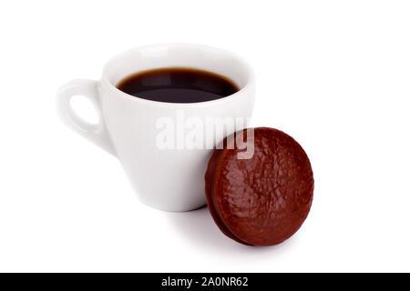 A cup of black coffee and a chocolate cupcake on a white background - Stock Photo