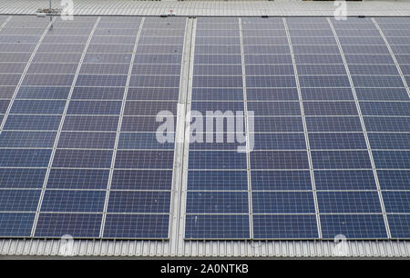 Solar panel roof on a building in the UK - Stock Photo