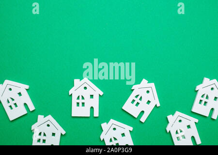 house wooden shape on green background - flat style - Stock Photo
