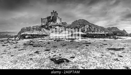 The ruins of the 13th century Eileen Tioram [The dry island] castle in the western Highland of Loch Moidart and River Shiel in monochrome