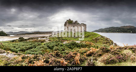The ruins of the 13th century Eileen Tioram [The dry island] castle in the western Highland of Loch Moidart and River Shiel