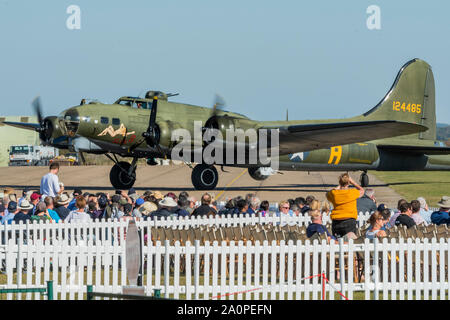 A Boeing B-17G Flying Fortress lands and taxis after a fly past - Duxford Battle of Britain Air Show at the Imperial War Museum. Also commemorating the 50th anniversary of the 1969 Battle of Britain film. It runs on Saturday 21 & Sunday 22 September 2019 Credit: Guy Bell/Alamy Live News - Stock Photo