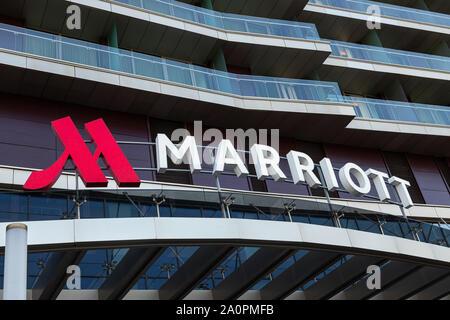 Minsk, Belarus - July, 2019. - Closeup of Marriott hotel logo above entrance to hotel - Stock Photo