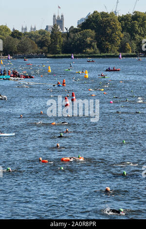 London, UK.  21 September 2019. General view of 6,000 participants taking part in the fourth Swim Serpentine, held in the famous lake in Hyde Park.  The event is raising thousands for Children With Cancer Charity UK as swimmers of all abilities navigate the one mile clockwise route around the lake. Credit: Stephen Chung / Alamy Live News - Stock Photo