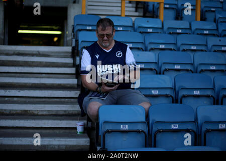 London, UK. 21st Sep, 2019. Millwall fan during the EFL Sky Bet Championship match between Millwall and Queens Park Rangers at The Den, London, England on 21 September 2019. Photo by Tom Smeeth. Editorial use only, license required for commercial use. No use in betting, games or a single club/league/player publications. Credit: UK Sports Pics Ltd/Alamy Live News - Stock Photo