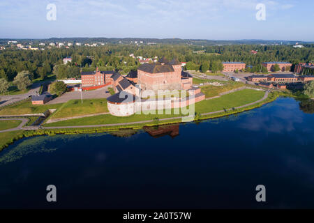 Hameenlinna fortress on the bank of the Vanayavesi lake in the solar July morning. Finland - Stock Photo