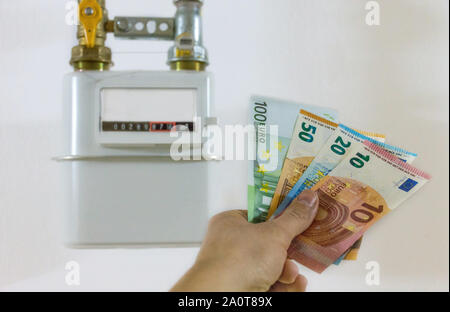 Energy efficiency concept with methane gas meter and euro currency – the cost of natural gas is more expensive. Selective focus. - Stock Photo