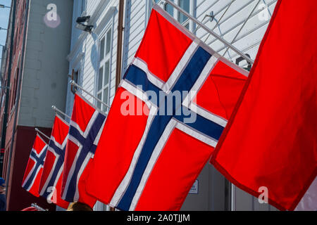 Row of Norwegian flags outside a shop in Stavanger - Stock Photo