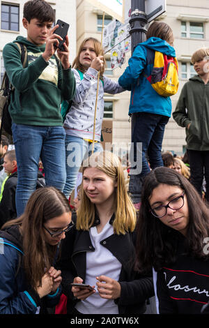 Berlin, Germany 9/20/2019 Young Students Attending The Global Strike Protesting Climate Change. Fridays For Future Demonstration In Berlin. - Stock Photo
