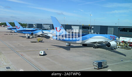 TUI Holiday Group Aircraft, gates 106-108 - Manchester Ringway Airport, Greater Manchester, North West England, UK - Stock Photo