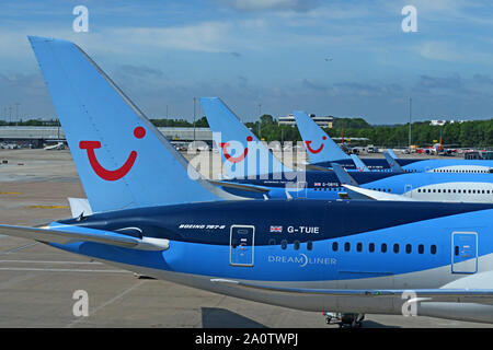 Three TUI Holiday Group Aircraft - Manchester Ringway Airport, Greater Manchester, North West England, UK - 787-8 G-TUIE Dreamliner - Stock Photo