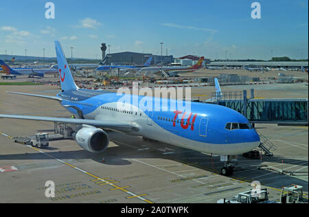TUI Holiday Group Aircraft - Manchester Ringway Airport, Greater Manchester, North West England, UK - G-OGYG tui 757-300 - Stock Photo