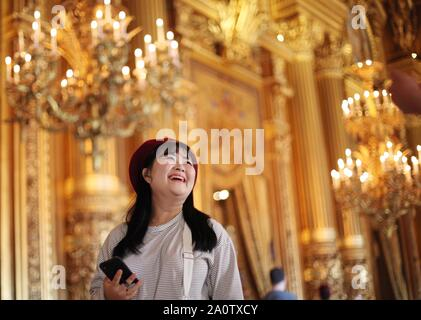 Paris, France. 21st Sep, 2019. A girl visits Paris Opera Theater during the European Heritage Days in Paris, France, Sept. 21, 2019. Historical heritage sites are open to public this weekend in France to mark the European Heritages Days, which are held in September each year. The European Heritages Days are the most widely celebrated participatory cultural event shared by the citizens of Europe. Credit: Gao Jing/Xinhua/Alamy Live News - Stock Photo