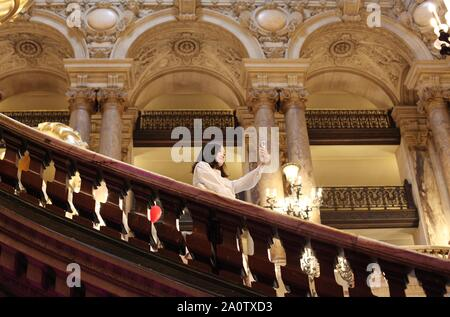 Paris, France. 21st Sep, 2019. A girl takes selfies at the Paris Opera Theater during the European Heritage Days in Paris, France, Sept. 21, 2019. Historical heritage sites are open to public this weekend in France to mark the European Heritages Days, which are held in September each year. The European Heritages Days are the most widely celebrated participatory cultural event shared by the citizens of Europe. Credit: Gao Jing/Xinhua/Alamy Live News - Stock Photo