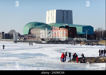 Hoorn, North Holland / Netherlands - March 11, 2012: Municipal Theater Het Park and icy sea coast in Hoorn city, Netherlands. - Stock Photo