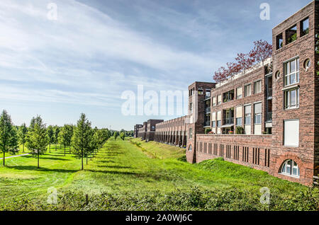 Den Bosch, The Netherlands, September 20, 2019: view along the south east face of Haverleij residential castle, in strong contrast with its green surr - Stock Photo
