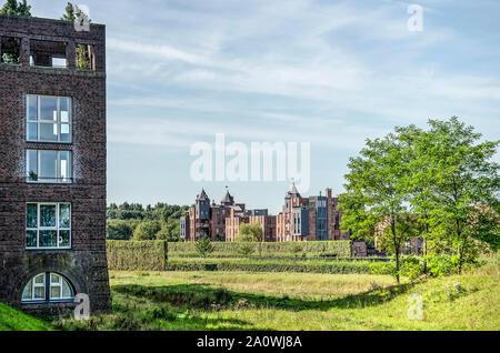 Den Bosch, The Netherlands, September 20, 2019: view from Haverleij castle residential estate across the green surroundings towards neighbouring Lelie - Stock Photo