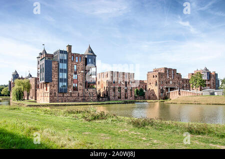 Den Bosch, The Netherlands, September 20, 2019: view from the north towards the entry facade of Lelienhuyze residential castle under a blue sky - Stock Photo