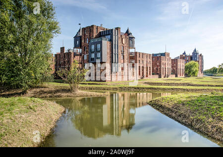 Den Bosch, The Netherlands, September 20, 2019: one of the corner towers of postmodern Lelienhuyze residential complex reflecting in the surrounding w - Stock Photo
