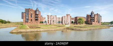 Den Bosch, The Netherlands, September 20, 2019: panoramic view of postmodern castle-like Lelienhuyze complex under a blue sky, reflecting in the surro - Stock Photo
