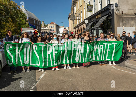 Many hundreds of schoolchildren & adults marched through the centre of Bristol demanding action on climate change. Part of a world-wide day of action. - Stock Photo
