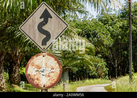 Phang Nga / Thailand - May 30 2018: Rusty road signs in Phang Nga Thailand - Stock Photo
