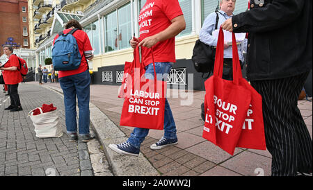Brighton UK 22 September 2019 - Labour Can Stop Brexit give away bags outside the Labour Party Conference being held in the Brighton Centre this year. Credit : Simon Dack / Alamy Live News - Stock Photo