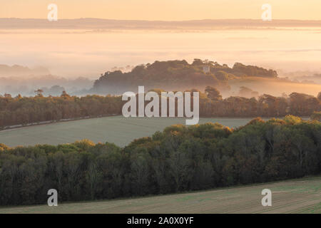 Layers of mist over the Sussex countryside near Firle. Firle, East Sussex, England - Stock Photo