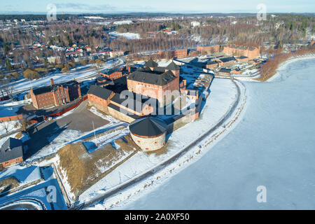 Above the ancient fortress of the city of Hameenlinna on a sunny March day (aerial photography). Finland - Stock Photo