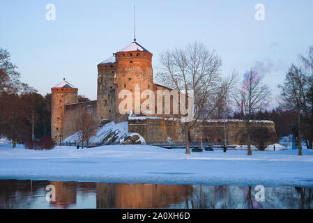 View of the ancient Olavinlinna fortress in March twilight. Savonlinna, Finland - Stock Photo