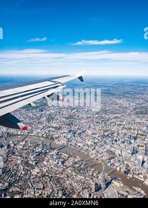 View from plane window with wing over Thames River & The Shard, London, England, UK - Stock Photo