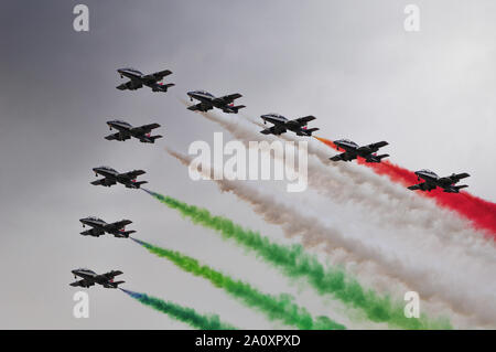 The Italian acrobatic air patrol, the Freccie Tricolori, in formation for a demonstration during the Breitling Sion Air show in the Swiss sky. - Stock Photo
