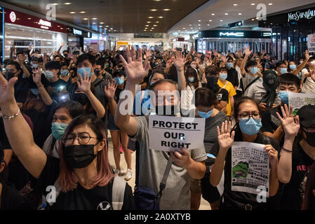 Protesters make gestures to symbolise the five demands during the demonstration.One more weekend, protesters set up barricade on fire, burned a Chinese flag and police fired pepper spray in renewed clashes over grievances by the anti-government demonstrators. - Stock Photo