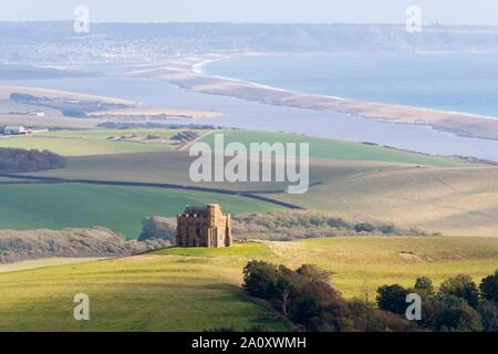 Abbotsbury, Dorset, UK.  22nd September 2019. UK Weather.  Sunshine breaks through the clouds to illuminate St Catherine's Chapel at Abbotsbury in Dorset on an afternoon of sunny spells and heavy blustery showers.  Picture Credit: Graham Hunt/Alamy Live News - Stock Photo
