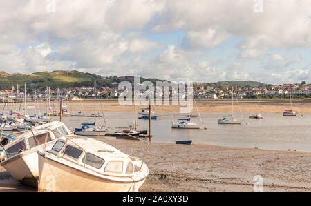 St George's Channel at Conwy.  Two boats are aground on the sand and others are afloat in the channel. A hill is in the distance and clouds are overhe - Stock Photo