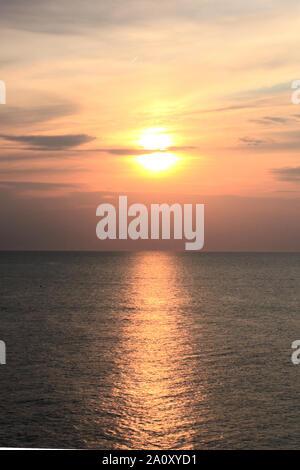 Beautiful view of the sunset at Scheveningen beach. This picture was taken from the pier at Scheveningen strand in Den Haag, Nederland. - Stock Photo