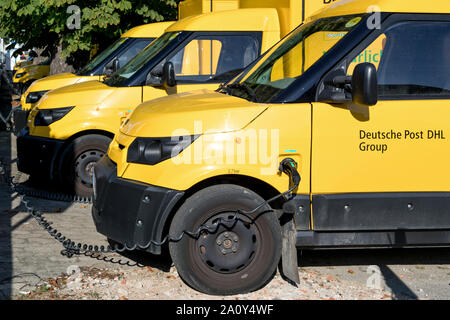 StreetScooter Work of Deutsche Post DHL being charged. - Stock Photo
