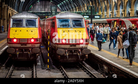 Two Virgin Rail InterCity 225 trains at London Kings Cross Station - Stock Photo