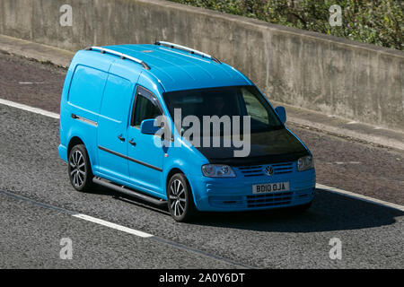 A VW Volkswagen Caddy van traveling northbound on the M6 motorway near Garstang in Lancashire, UK. - Stock Photo