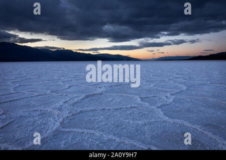 Polygon salt pans of the Badwater flats in Death Valley National Park, California - Stock Photo
