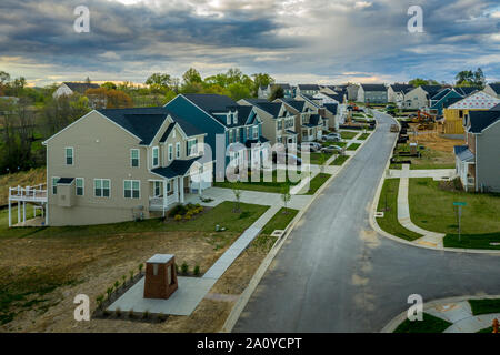 Aerial landscape of typical American new construction neighborhood in Maryland for the upper middle class, single family homes real estate - Stock Photo