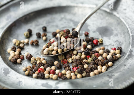 Mixed peppercorns on spoon - Stock Photo