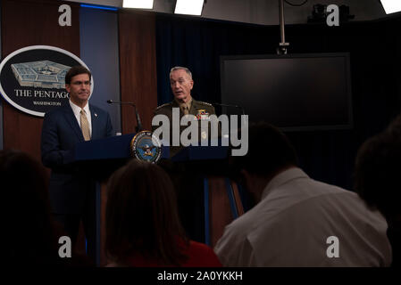 U.S. Secretary of Defense Mark T. Esper and the chairman of the Joint Chiefs of Staff, Marine Corps Gen. Joe Dunford, hold a press briefing at the Pentagon, Washington, D.C., Sept. 20, 2019. (DoD photo by Lisa Ferdinando) - Stock Photo