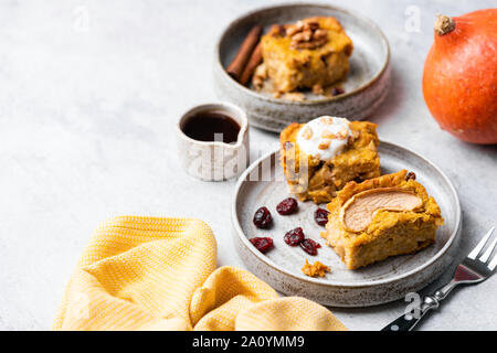 Pumpkin cake square with walnuts, dried cranberry and yogurt on plate. Healthy american pumpkin pie - Stock Photo