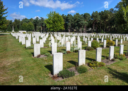Rows of gravestones and cross in the Canadian Section of the Military Cemetery at Brookwood Cemetery, Pirbright, Woking, Surrey, southeast England, UK - Stock Photo